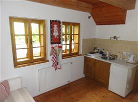Kuchyň s jídelnou a rozkládacím gaučem