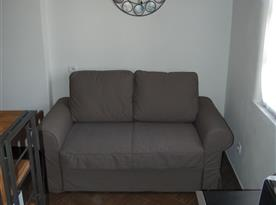 Rozkládací sedačka u spací části