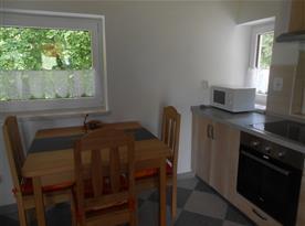 Apartmán II. - kuchyně s jídelním koutem